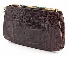 Judith Leiber rouge alligator skin clutch