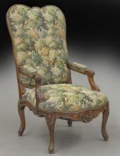 French carved walnut upholstered arm chair