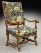 Louis XIII style carved walnut arm chair with