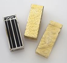(3) Dunhill lighters, two in their original boxes.