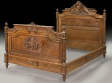 French carved Circassian walnut bed, signed Dufin,