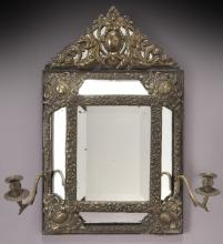 Continental embossed metal and wood frame mirror,