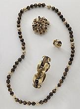 4 Pcs. 18K gold, diamond and tiger's eye jewelry