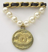 Chanel gilt medallion, pearl and leather brooch,