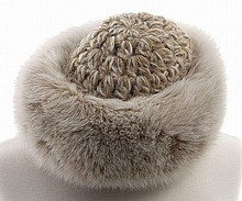 White fox fur and knitted wool hat.
