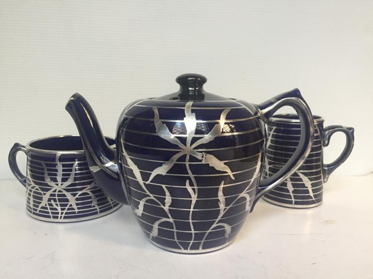 Ceramic teaset with silver decoration