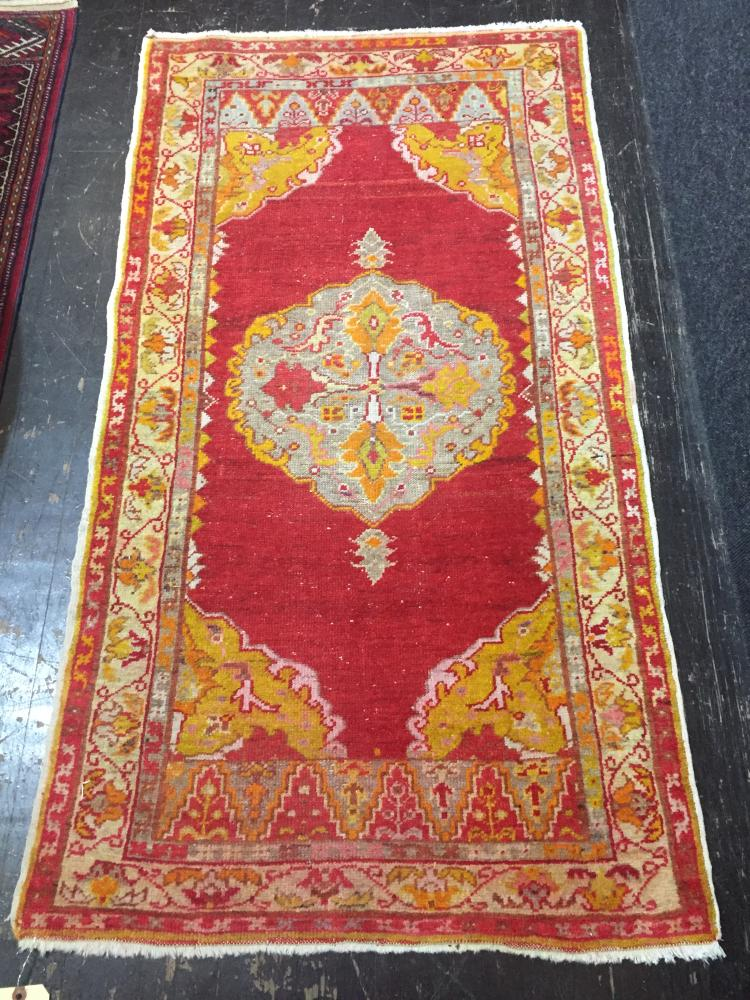 Two Turkish scatter rugs, 29