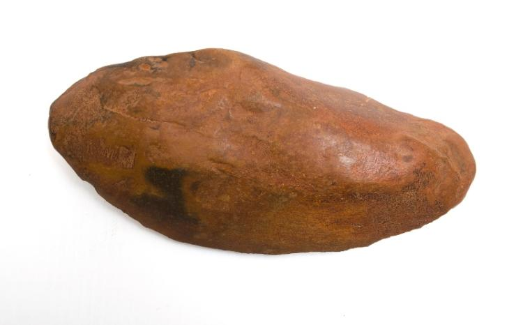 Aboriginal Stone Chopper.  Long quartz stone with ochre coating. Provenance: Bungan Castle Museum collection.