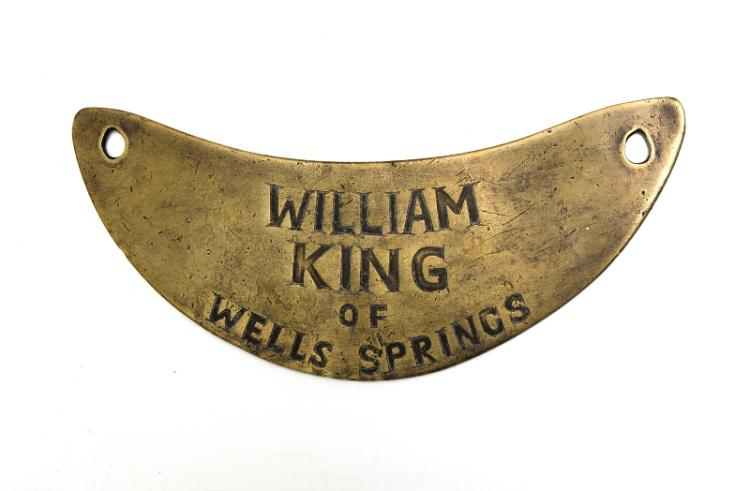 Aboriginal King Plate.  Crescent form, brass block engraved 'William King of Wells Springs.' Provenance: Bungan Castle Museum collection.