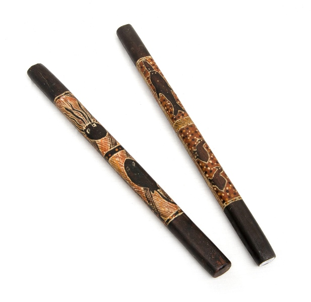 Pr Mid 20th C Groote Eyland Clapsticks. Ochre decorations of marine & land animals. Incl. dugong, octopus, ray, & emu chicks. 2 mounting holes to each stick.