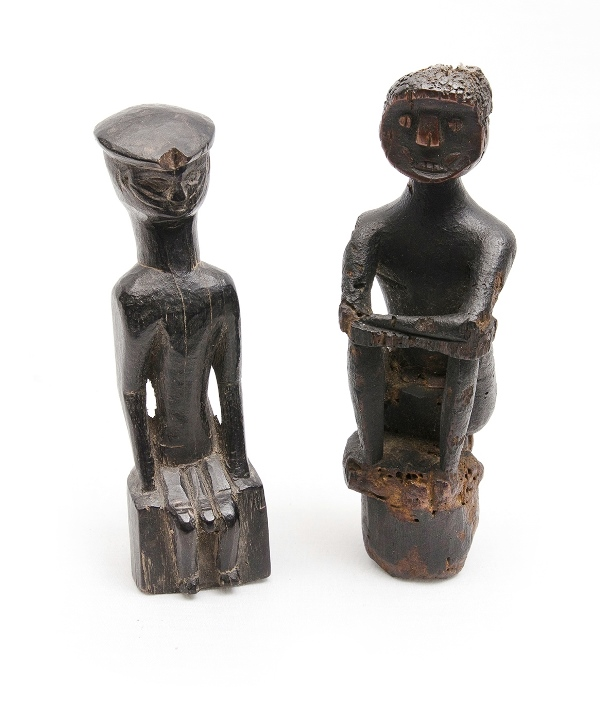 2 Older Dyak Magic Figures. Carved wood seated figures, 1 with losses.
