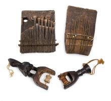 4 Var African Artefacts.  Incl. 2 carved decorated loom pulleys; & 2 thumb harps.