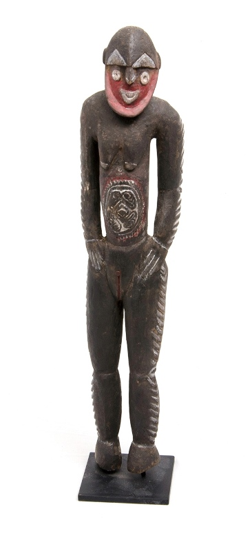 Papua New Guinea Early Sepik Nogwi Figure.  Carved standing female figure. Natural pigment decoration. On metal stand. Provenance: private collection.