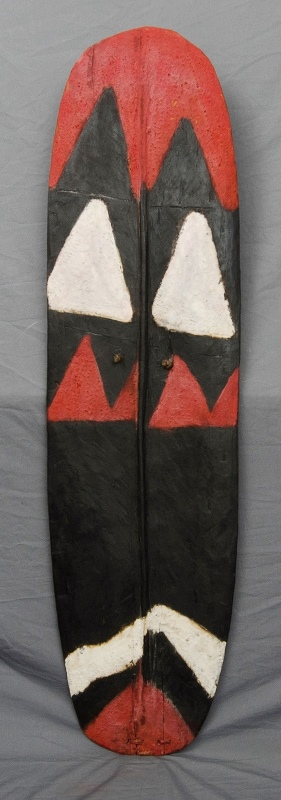 Papua New Guinea Highlands Shield.  Red, black & white natural pigments.  Provenance: collected c1960 by Australian Patrol Officer, Ian Leslie Kelly, thence held in a private collection.