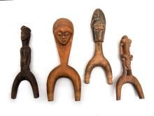 4 Var West African Heddle Pulleys.  3 with carved face decoration; 1 with carved lizard decoration (restored).