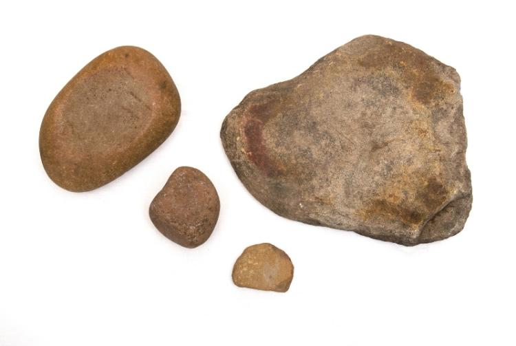 Aboriginal Grinding Stones (2).  Round river stone with hollow & grinder; double sided tablet, one side with groove & small grinder. Collected Walgett c1960.