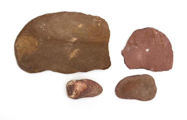 Aboriginal Grinding Stone (2).  Red sedimentary tablet with hollow & pointed grinder; pr small flat stones. Collected Walgett c1960.