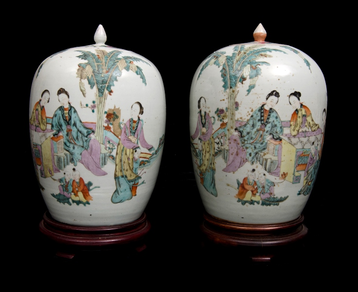 Pr Chinese Republic Period Lidded Porcelain Urns.  Painted ladies at leisure decoration, signed by the artist, together with verse in characters. Each on wooden stand.
