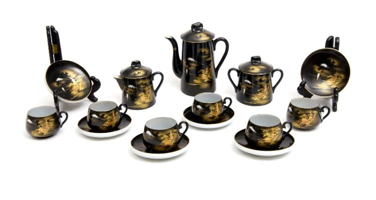15 Pce Japanese Porcelain Coffee Set.  Incl. coffee pot; sugar bowl; cream jug; & 6 cups & saucers. Pagoda & Mt. Fuji decoration on black ground with gilt highlights. Red character mark to bases.