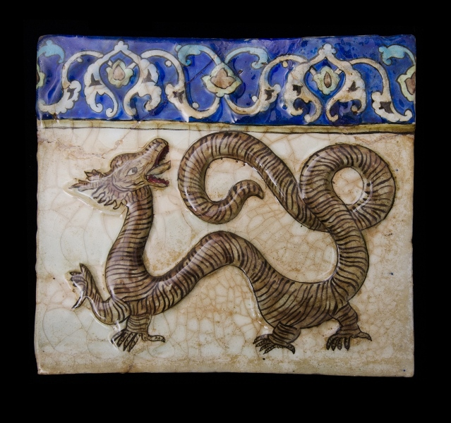 19th C Qalar Tile.  Dragon decoration.  Blue floral freize to top edge. Decoration is in the 14th C style.