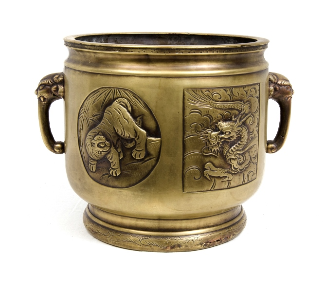 Early Chinese Bronze Jardiniere.  Dual lion head handles. Embossed decoration of dragon & other animals.