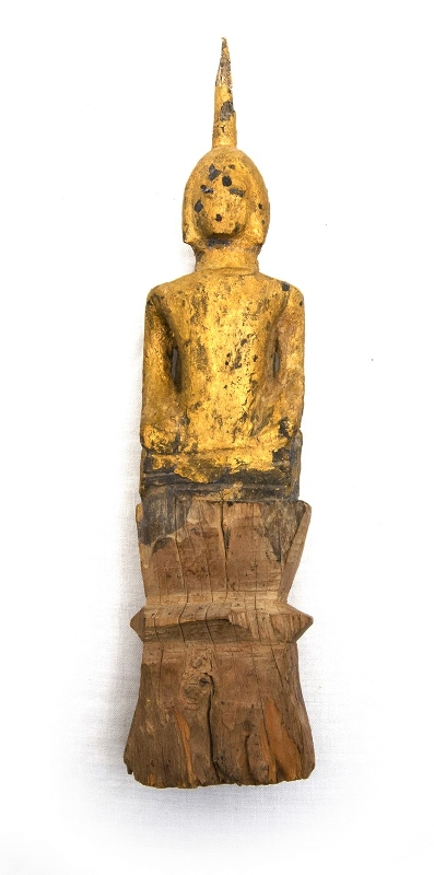 Early Laos Carved Wood Buddha.  Gilt over lacquer with glass eyes. (some wear to gilding). Cracks to wooden base.
