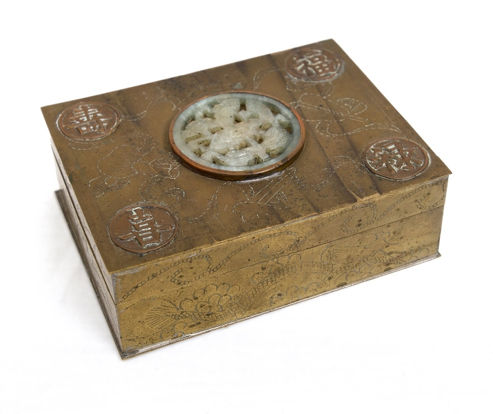 Circa 1930s Chinese Brass Cigarette Box.  Greenstone insert to lid, wood lined. Hinges loose.