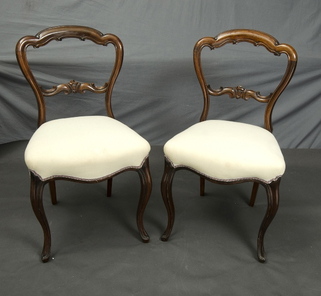 Pr Victorian Carved Back Salon Chairs. Each with white cotton upholstery.