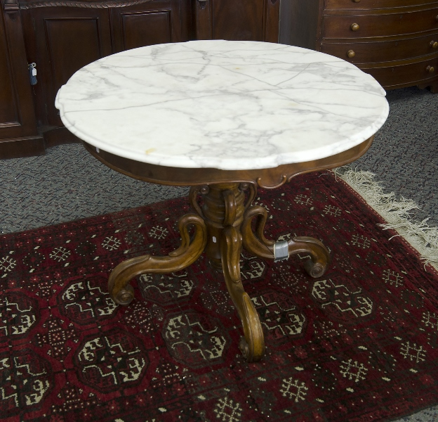 Vict Central Pedestal Marble Topped Table.  White marble circular top (restored, as inspected) over central carved pedestal to quad feet (1 fractured).