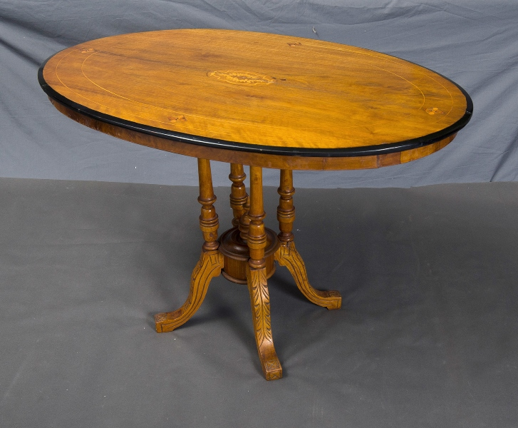 Victorian Walnut Oval Topped Table. Birdcage base. Marquetry decoration & string inlay to top.