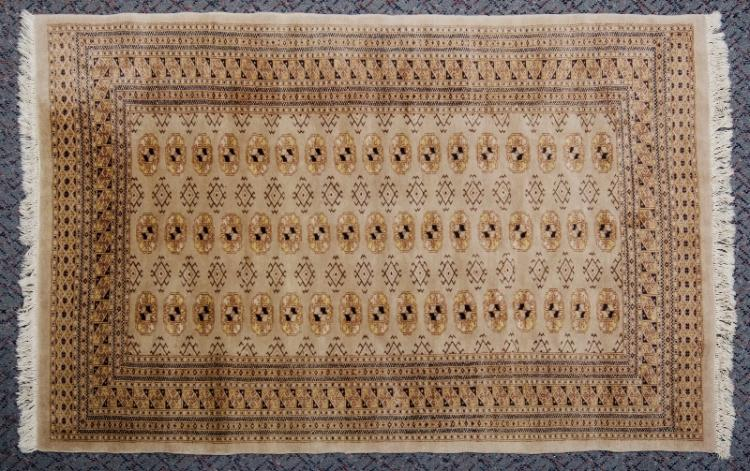 Middle East Bokara Wool Carpet. Camels foot design, on tan ground.