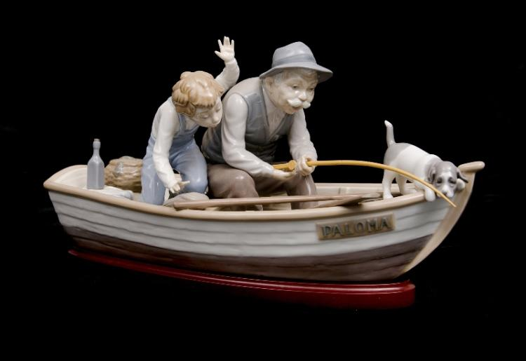 Lladro Fisherman & Boy in Boat. With wooden base & cane fishing rod.