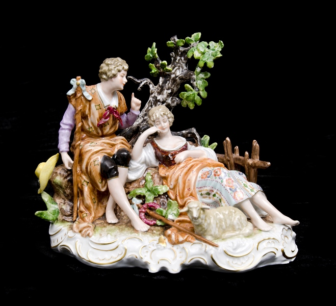 German Porcelain Courting Couple Figure. Couple with sheep to foot. Stamped to base.