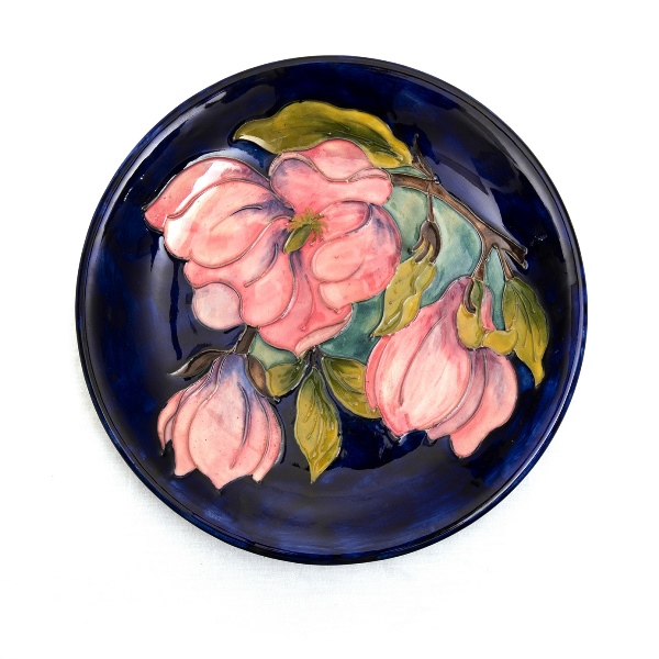 William Moorcroft Magnolia Plate.  Magnolia on blue ground. Original paper label to base.