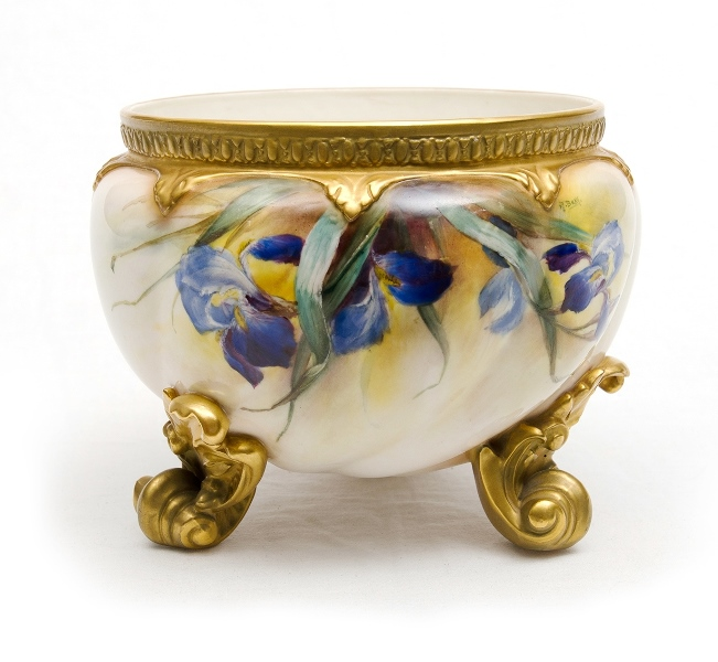Royal Worcester Signed Porcelain Jardiniere. Signed F J Bray. Blue iris floral decoration with gilt highlights on shell form feet. Marked to base 1450-38-54. c1912.