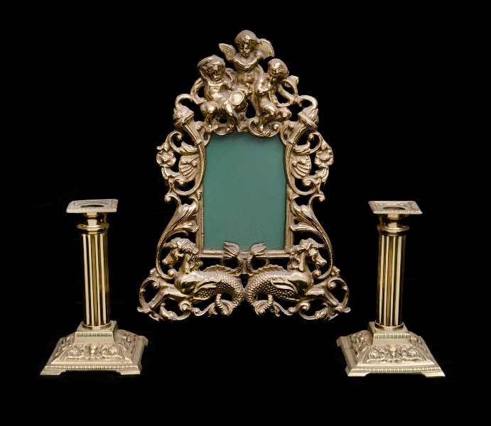 3 Var Brass Items.  Incl. ornamental table mirror frame; & pr candle sticks, column shaped.
