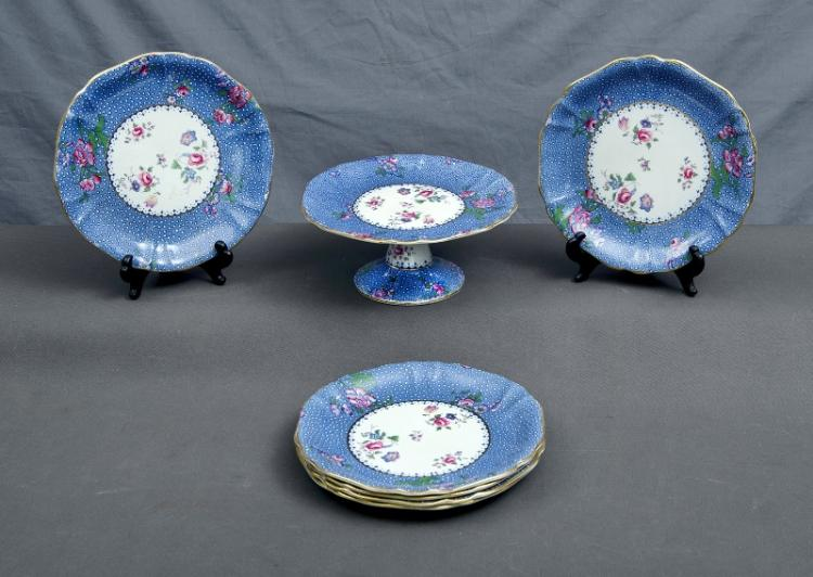 Early 7 Pce Wedgwood Dessert Set. Incl. 6 plates & 1 comport. Blossom decoration, blue margins, gilt rims. Marked #914 to bases. 1 plate as inspected.
