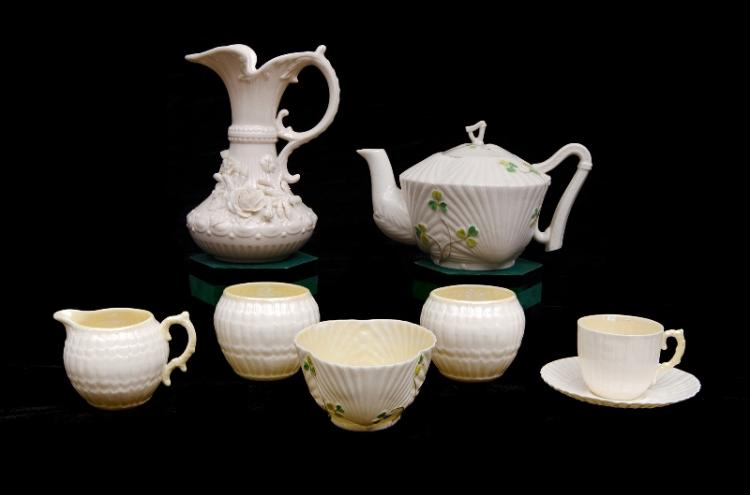 8 Var Belleek Porcelain Items. Incl. teapot & sugar bowl, clover decoration, black mark, second version; & ewer, cup, saucer, cream jug & 2 sugar bowls; all with green mark.