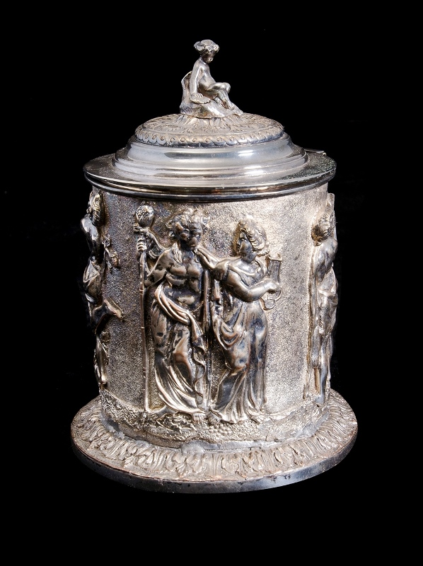 Early Ornamental Silver Plate Biscuit Barrel.  Embossed classical figures to sides. Child finial to lid (some wear to plate).