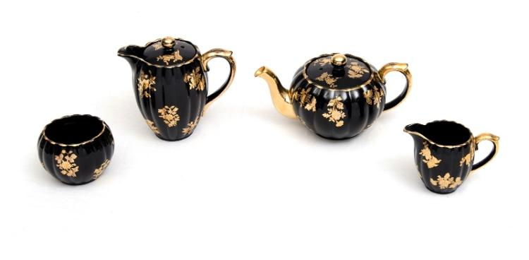 4 Pce Gibson English Porcelain Tea & Coffee Pots etc.  Incl. coffee pot; teapot; sugar bowl; & cream jug. Gilt floral decoration on black ground. Marked to bases.