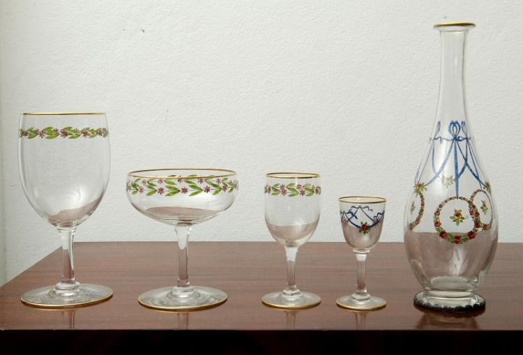 2 Similar Sets Hand Painted Wine Glasses.  Incl. total 24 leaf & petal painted wine glasses; & blossom & garland painted 14 pce liqueur set of 12 glasses & 2 matching carafes. All with gilt rims.