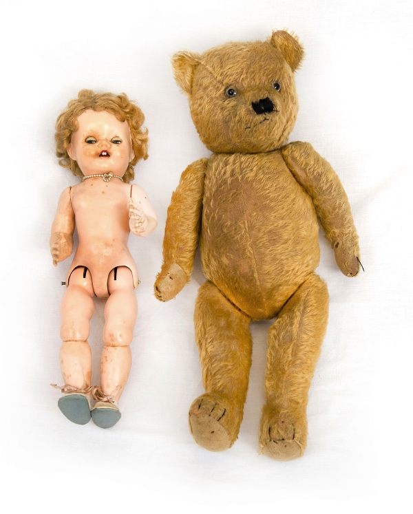 Pedigree Doll & Teddy Bear.  Doll with composite head & body. Opening eyes & flexible limbs. 2 dresses available. Teddy bear in as inspected condition.
