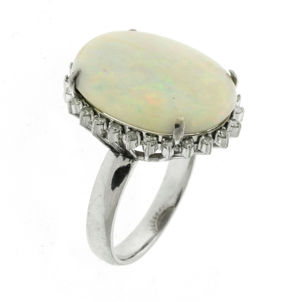 14ct White Gold Opal & Diamond Ring.  Large white oval opal surrounded by diamonds. Total diamonds approx. 0.25ct
