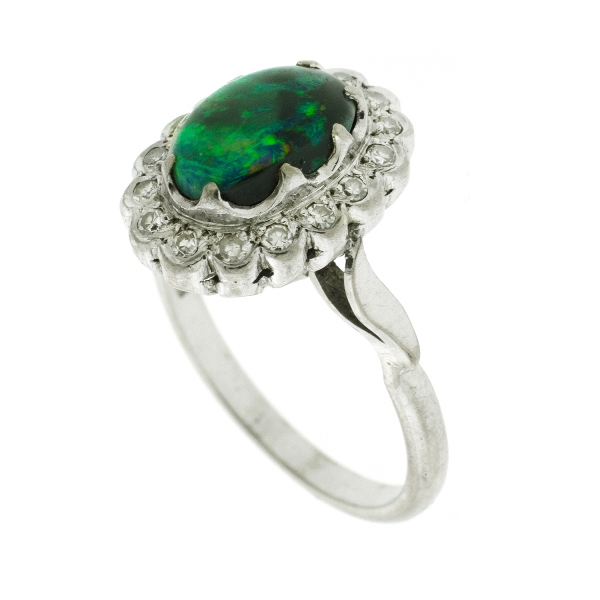 18ct White Gold Opal & Diamond Ring.  Oval opal surrounded by 16 diamonds (total approx. 0.16ct).