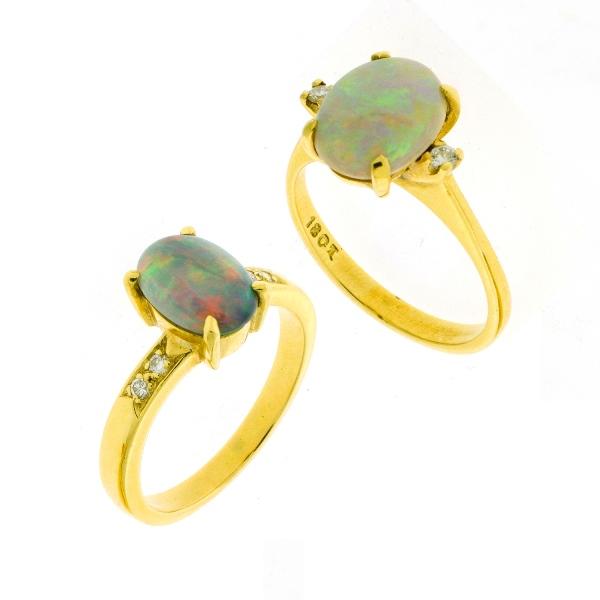 2 Var 18ct Yellow Gold Opal Rings.  Both diamond set.