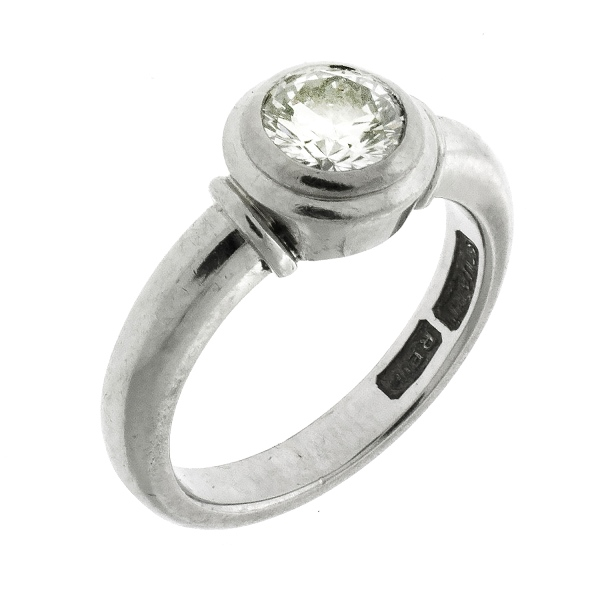 Platinum Solitaire Diamond Ring. Bezel set diamond (approx. 0.75ct).