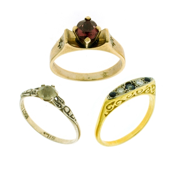 3 Var Stone Set Rings.  Incl. yellow 9ct yellow gold garnet set; 18ct yellow gold diamond & sapphire; & 10ct plated on silver set with white stone.