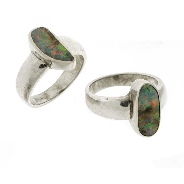 2 Var Silver Opal Rings. Both bezel set.