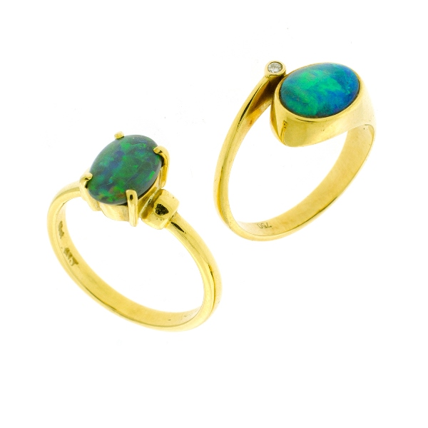 2 Var 18ct Yellow Gold Opal Rings. Both oval shaped. 1 with 1 shoulder diamond.