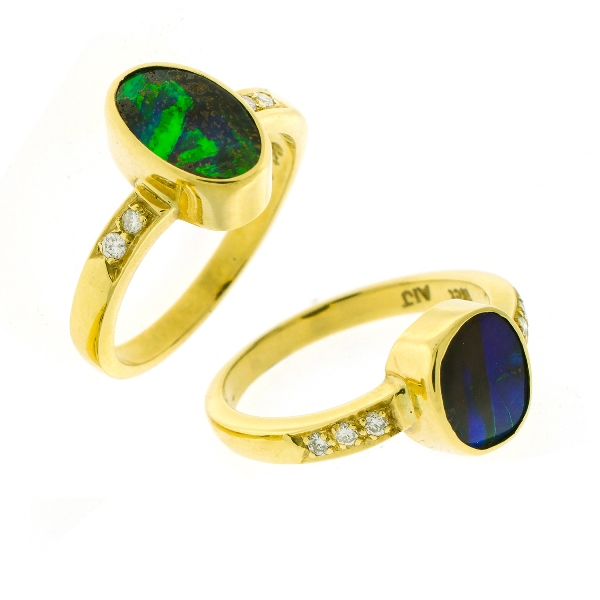 2 Var 18ct Yellow Gold Opal & Diamond Rings.  Both bezel set oval opals with 6 each shoulder diamonds.